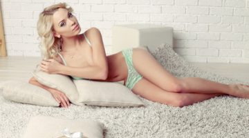 woman with long blond curly hair in elegant lingerie